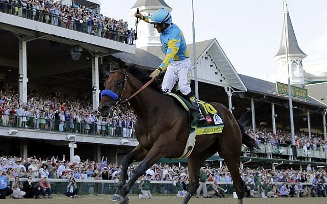 Jockey Victor Espinoza celebrates aboard American Pharoah after winning the 141st running of the Kentucky Derby horse race at Churchill Downs in Louisville, Ky, May 2, 2015 (AP/David J. Phillip, File)
