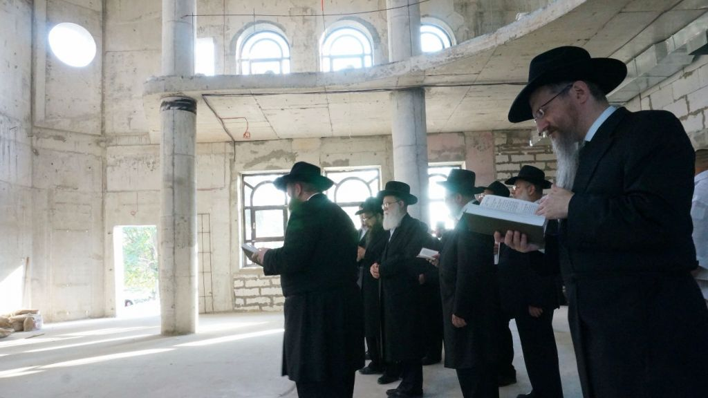 Rabbi Berel Lazar, foreground, with congregants at an unfinished synagogue in Sevatopol, Crimea, July 14, 2014. (Cnaan Liphshiz/JTA)