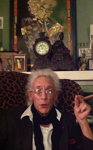 Bill Levin at home, with family menorah in upper right.  (Youtube screenshot)