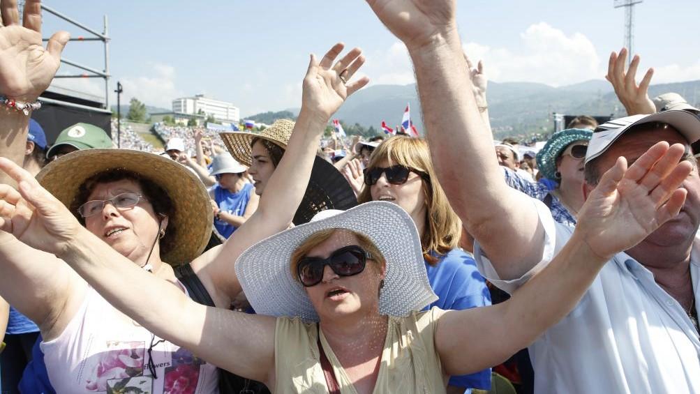 Faithful attend a Mass celebrated by Pope Francis at the Kosevo stadium, in Sarajevo, Bosnia-Herzegovina, Saturday, June 6, 2015. (AP Photo/Amel Emric)
