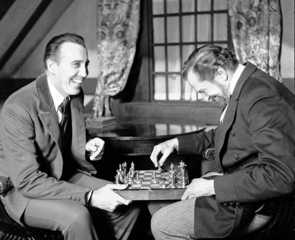 "In this file photo dated Dec. 17,1968, British actor Christopher Lee, left, and American actor Vincent Price, share a joke whilst playing chess during a break in the filming of Edgar Allen Poe's ""The Oblong Box"", at Shepperton Studios, England. (AP Photo/Bob Dear, FILE)"