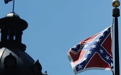 The Confederate flag flies near the South Carolina Statehouse, Friday, June 19, 2015, in Columbia, South Carolina (AP Photo/Rainier Ehrhardt)
