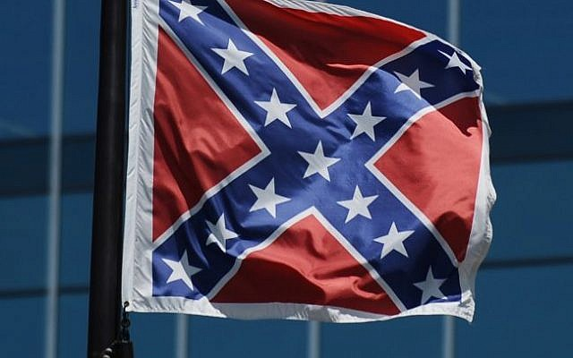 The Confederate flag flies near the South Carolina Statehouse, Friday, June 19, 2015, in Columbia, South Carolina (AP Photo/Rainier Ehrhardt)