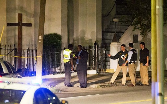 Police stand outside the Emanuel AME Church following a shooting on June 17, 2015, in Charleston, South Carolina. (David Goldman/AP)