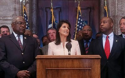 South Carolina Governor Nikki Haley speaks next to Congressman James Clyburn (L) and Senator Tim Scott (R) during a news conference in the South Carolina State House on June 22, 2015. (Tim Dominick/The State via AP)