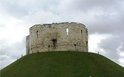 Clifford's Tower in the city of York, a major hub for Jewish economic activity and the site of an early Jewish pogrom in 1190 (Soerfm, CC-BY-SA, via wikipedia)