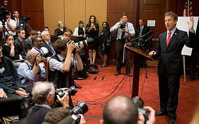 Republican presidential candidate, Sen. Rand Paul, R-Ky. speaks at a news conference on Capitol Hill in Washington, Tuesday, June 2, 2015, to call for the 28 classified pages of the 9-11 report to be declassified. (AP Photo/Andrew Harnik)