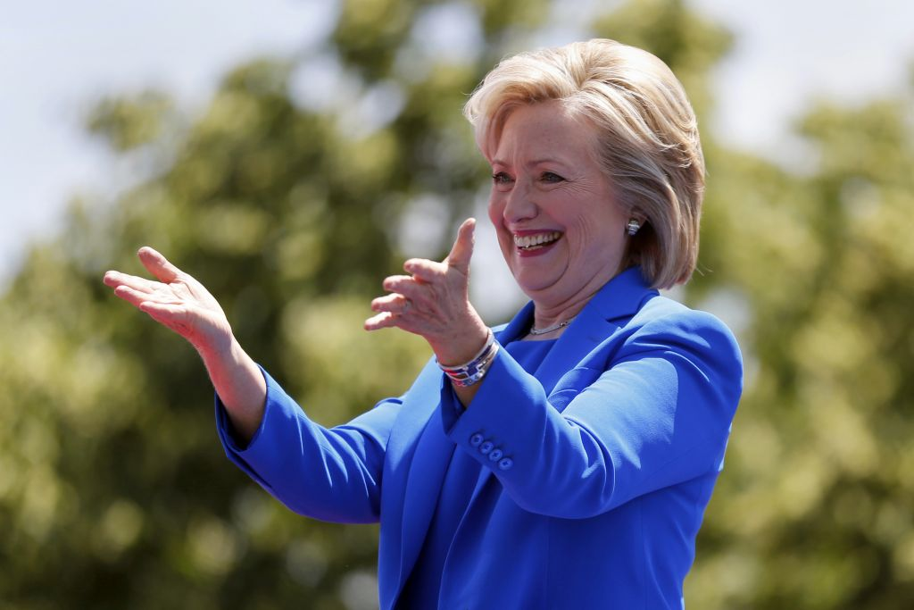 Democratic presidential candidate, former Secretary of State Hillary Rodham Clinton, gestures to supporters as she arrives to speak Saturday, June 13, 2015, on Roosevelt Island in New York. (AP Photo/Julio Cortez)