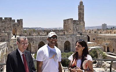 Professional baseball player Mariano Rivera (center) and Eilat Lieber, director of the Tower of David Museum (right), meet Minister of Tourism Yariv Levin at the Tower of David in the Old City of Jerusalem, June 18, 2015. (Hamutal Wachtel)