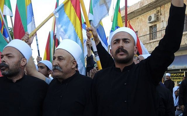 Druze chant at a pro-Syria protest in Majdal Shams on Monday. (Melanie Lidman/Times of Israel)