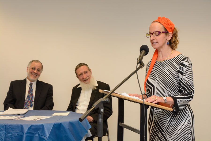 Rabbis Meesh Hammer-Kossoy (speaking, far right), Daniel Sperber (center) and Herzl Hefter at the June 9, 2015 celebration marking the ordination of the first cohort of Har'el Beit Midrash. (Sigal Krimolovski)