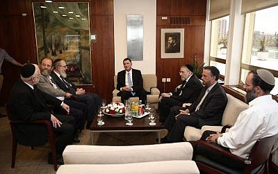 Knesset Speaker Yuli Edelstein meets with a group of Orthodox rabbis at his office following the torching of the Tabgha church, June 25, 2015. (Yuli Edelstein Facebook page)