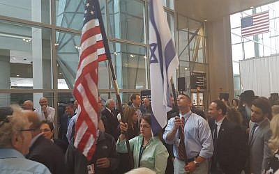 Officials from El Al Israel Airlines and Boston's Massachusetts Port Authority carry the US and Israeli flags during a launch ceremony for El Al's new Boston-TLV nonstop flights, held on June 28, 2015 at Logan International Airport. (Matt Lebovic)