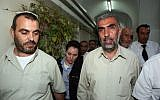 Sheikh Kamal Khatib of the Islamic movement, right, is brought to arraignment in a Jerusalem court after being arrested for provoking riots on the Temple Mount and East Jerusalem, October 4, 2009. (Matanya Tausig/Flash90)