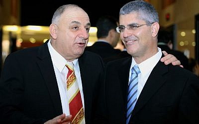 Haim Romano, right, and Yitzhak Tshuva on December 08 2007. (Moshe Shai/FLASH90)