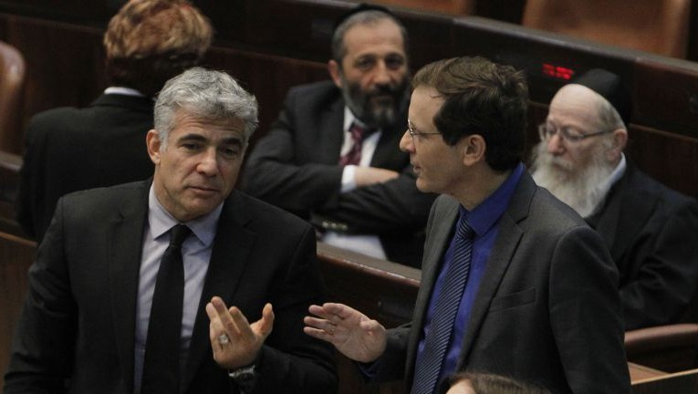 Yesh Atid's Yair Lapid (left) with Zionist Union's Isaac Herzog in the Knesset in 2013. (Photo by Miriam Alster/FLASH90)