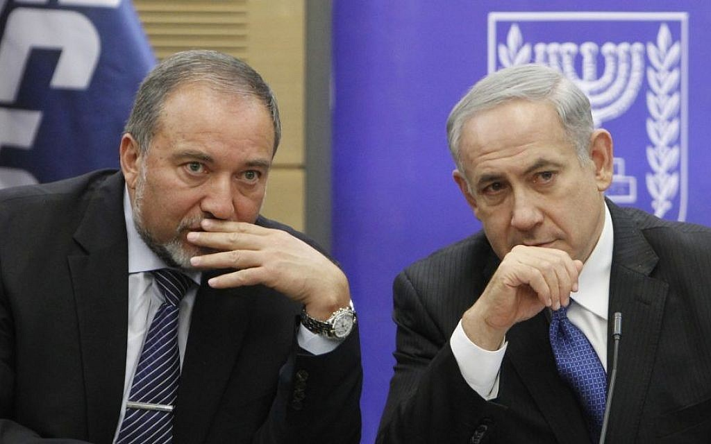 Prime Minister Benjamin Netanyahu and then-foreign minister Avigdor Liberman in the Knesset, February 3, 2014. (Yonatan Sindel/Flash90)