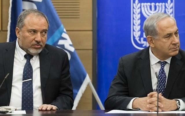 Prime Minister Benjamin Netanyahu and then-foreign minister Avigdor Liberman in the Knesset, February 3, 2014. (FLASH90)