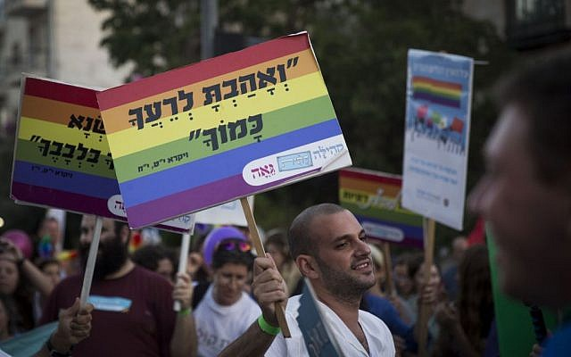 People marching at a gay pride parade in Jerusalem on September 18, 2014. (Hadas Parush/Flash90)