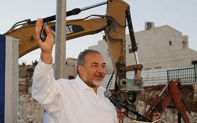 Avigdor Liberman speaks at a cornerstone laying ceremony for a new synagogue at his home settlement of Nokdim, October 23, 2014. Photo by Gershon Elinson/Flash90