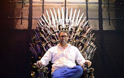 Knesset member Oren Hazan sits in a model of the Iron Throne from TV's 'Game of Thrones' during an exhibition in Tel Aviv on Sunday April 5, 2015 (Tomer Neuberg/Flash90)