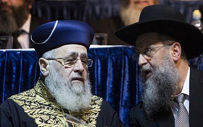 Sephardic Chief Rabbi Yitzhak Yosef, left, speaks with his brother David Yosef, April 5, 2015. (photo credit: Yonatan Sindel/Flash90)