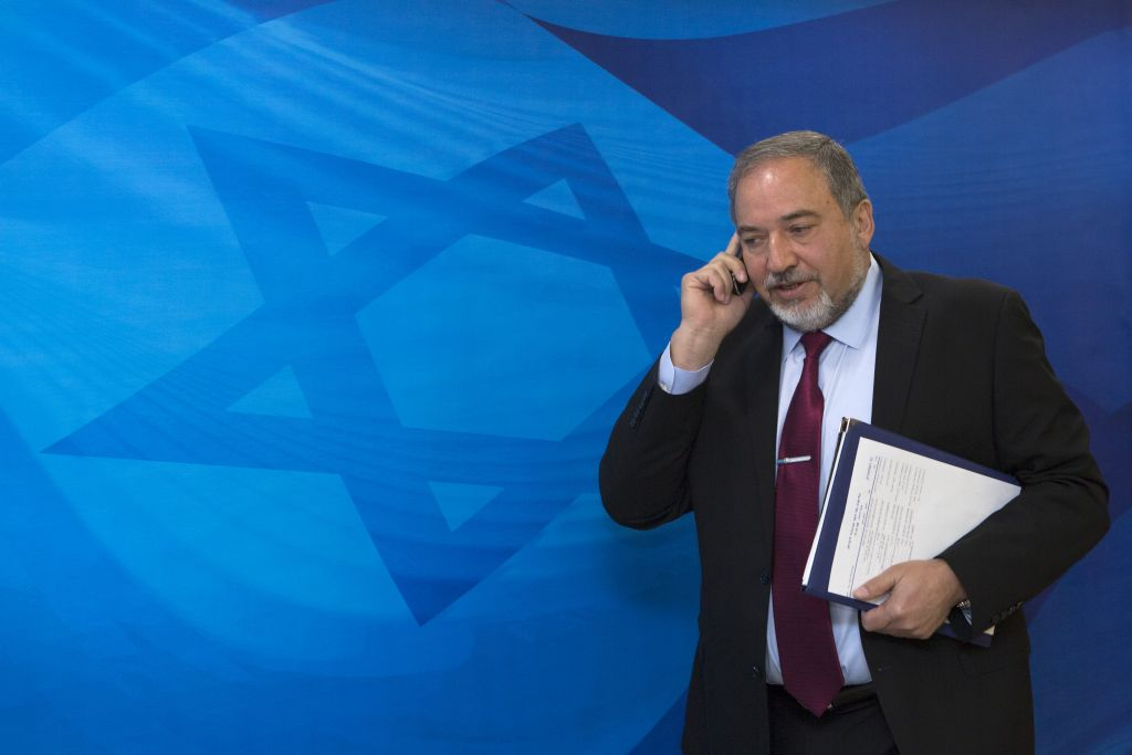 Then foreign minister Avigdor Liberman arrives for a cabinet meeting, at the PM's office in Jerusalem, on April 19, 2015. (Photo by Olivier Fitoussi/POOL)