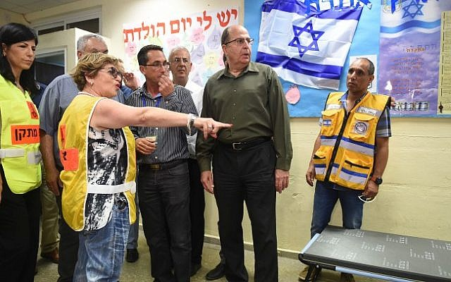 """Defense Minister Moshe Ya'alon seen during an emergency drill as part of the """"Turning Point 15"""" exercise, at a school in Rishon Lezion on June 1, 2015  (Diana Hananshvili/Ministry of Defense)"""
