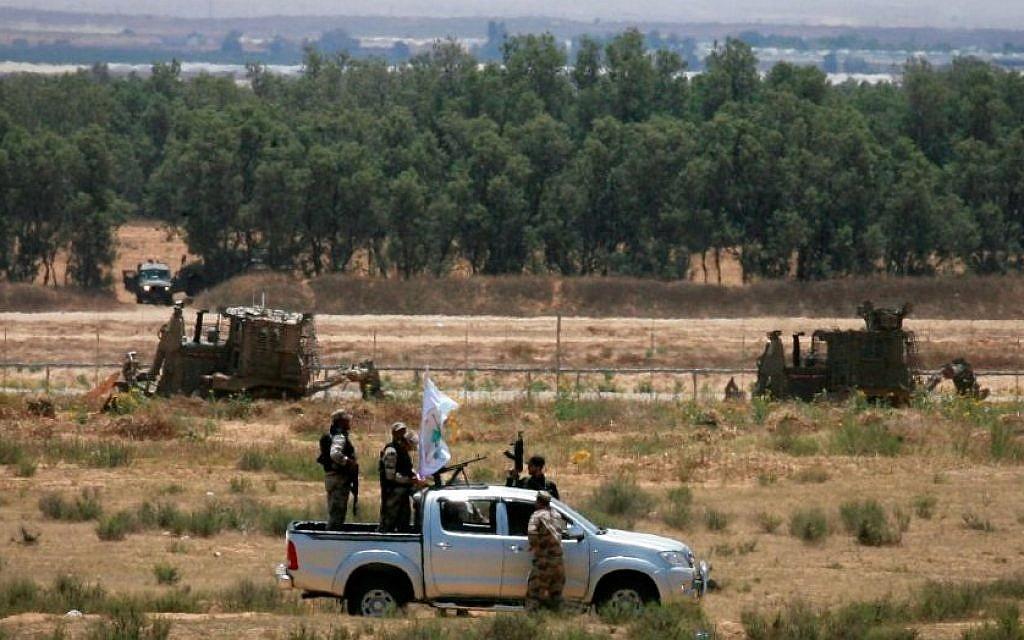 Gunmen from the Izz ad-Din al-Qassam Brigades, Hamas' armed wing, patrol an area near the Israeli border with Rafah in the southern Gaza Strip on June 3, 2015 (Abed Rahim Khatib/Flash90)
