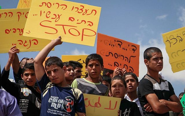 Arab Israelis and Bedouins protest at Beersheba city hall against the Israeli court's recent decision to evacuate the Bedouin village of Umm al-Hiran on June 11, 2015. (Talucho/Flash90)