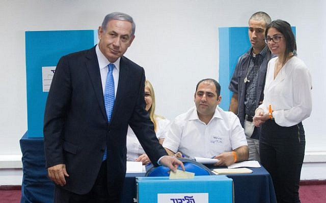 Prime Minister Benjamin Netanyahu votes at a polling station in Jerusalem on the method of elections within the Likud party, June 14, 2015. (Miriam Alster/FLASH90)