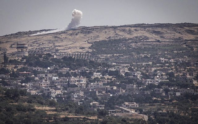 View of bombing between Syrian forces from the Israeli side of the border with Syria in the Golan Heights due, on June 16, 2015. (Basel Awidat/Flash90)