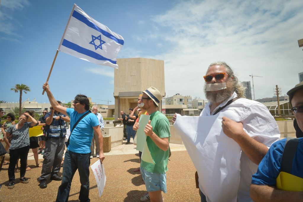 "Israelis wear tape across their mouths to protest Minister of Culture Miri Regev's ostensible ""silencing"" of dissident voices, outside an award ceremony for Israeli theatre where Regev was present, in Tel Aviv, on June 19, 2015. Photo by FLASH90"