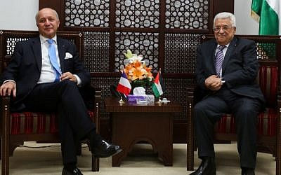 French Foreign Minister Laurent Fabius meets with Palestinian Authority President Mahmoud Abbas in the West Bank city of Ramallah on June 21, 2015. (Flash90)