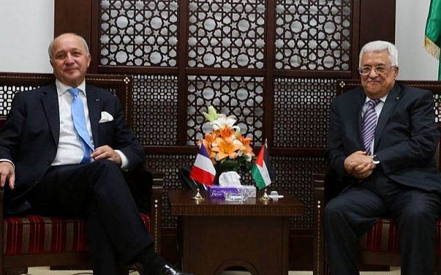 French Foreign Minister Laurent Fabius (L) meets with Palestinian Authority President Mahmoud Abbas in the West Bank city of Ramallah on June 21, 2015 (Flash90)