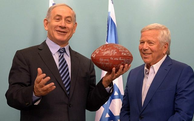 New England Patriots owner Robert Kraft gives Prime Minister Benjamin Netanyahu a signed football during a meeting with former players at the Prime Minister's Office in Jerusalem on June 22, 2015. (Amos Ben Gershom/GPO)