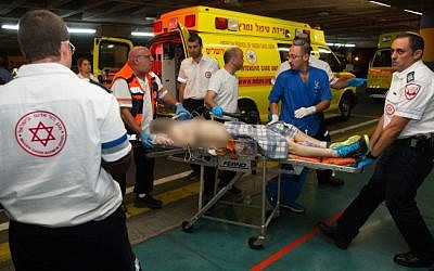 One of four Israeli men who were wounded in a drive-by shooting terror attack near Shvut Rachel, is brought to the Shaare Zedek Hospital in Jerusalem on June 29, 2015. (Yonatan Sindel/Flash90)