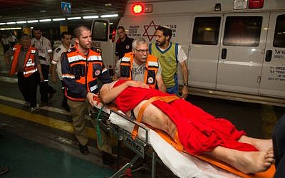 An Israeli wounded in a drive-by shooting attack is brought to Shaare Zedek hospital in Jerusalem, June 29, 2015. (Yonatan Sindel/Flash90)