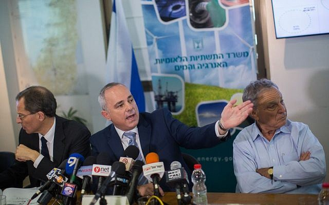 Minister Yuval Steinitz, center, speaks as he presents the guidelines for regulating the country's offshore natural gas reserves at a press conference in Jerusalem on June 30, 2015. (Yonatan Sindel/Flash90)