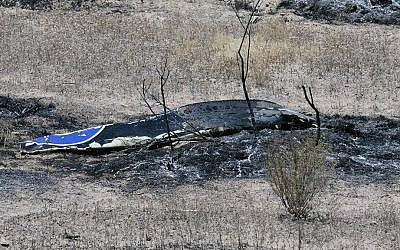 Scattered debris remains on the ground following a plane crash near the town of Ventucopa, Calif., Monday, June 22, 2015. (Mike Eliason/Santa Barbara County Fire Department via AP)