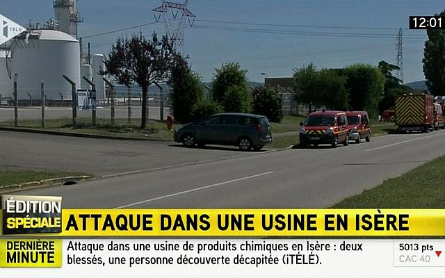 Emergency services outside a factory where a man was beheaded in a terrorist attack, in Saint-Quentin-Fallavier, France, Friday, June 26, 2015. (I Tele via AP)