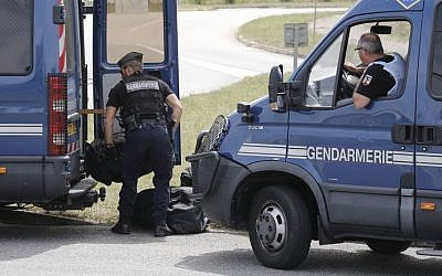 Riot police officers block the area where an attack took place, Friday, June 26, 2015 in Saint-Quentin-Fallavier, southeast of Lyon, France.  (AP/Laurent Cipriani)