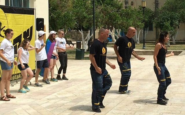 Birthright Israel participants (left) dance with members of the Sheketak troupe at the Suzanne Dellal Center in Jaffa, June 9, 2015. (Renee Ghert-Zand/Time of Israel)