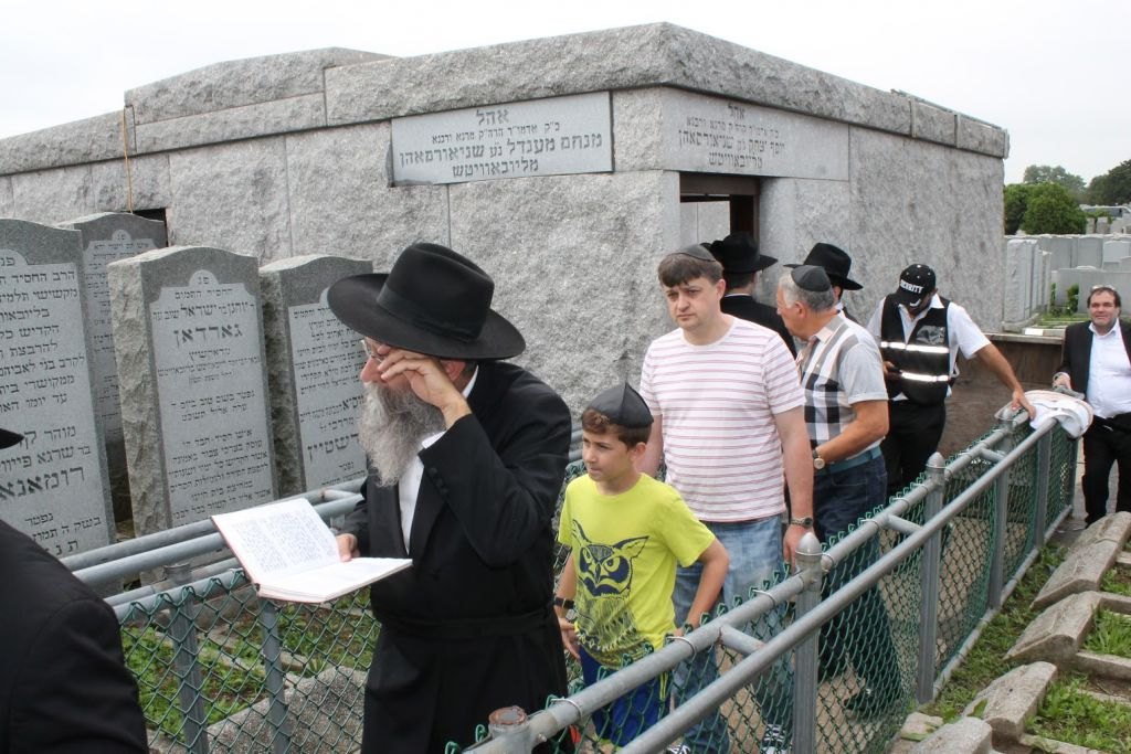Male visitors on June 21, 2015 exit the 'Ohel,' the grave of the Lubavitcher Rebbe Menachem Mendel Schneerson, on the 21st anniversary of his death. (Hannah Dreyfus/The Times of Israel)