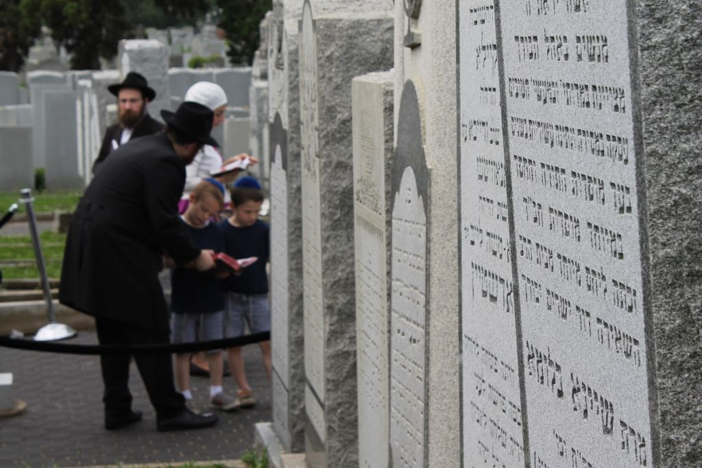 Chabad families often make the pilgrimage to the 'Ohel,' the New York grave of Rebbe Menachem Mendel Schneerson, to celebrate lifecycle events. (Hannah Dreyfus/The Times of Israel)