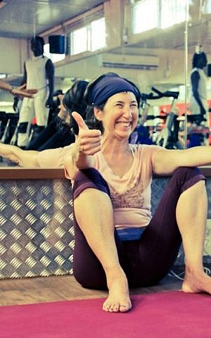 Karen Zivan, a yoga instructor and mother of five boys, has a deep desire to bring yoga and its calming techniques to the IDF (Courtesy Masa L'Koach)