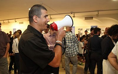 A man speaking instruction into a megaphone during a siren drill at the Knesset in Jerusalem on June 2, 2015. (Courtesy Knesset spokesperson)