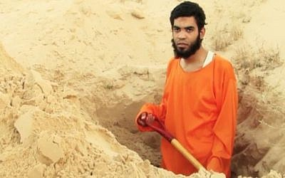 A prisoner of Ansar Bayt al-Maqdis in the Sinai Peninsula is forced to dig his own grave in a video released June 9, 2015. (Screenshot)