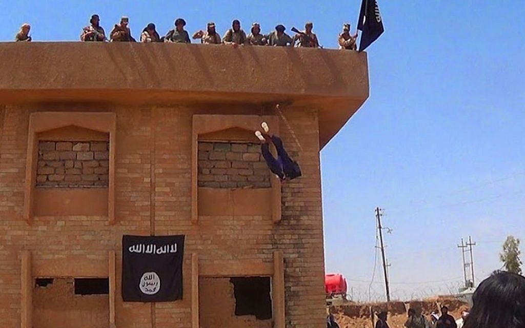 Islamic State militants kill a man they accused of being a homosexual by throwing him off a building in Syria's northeastern province of Hassakeh, in this verified photo released by a militant website on Jan. 14, 2015. (Militant website via AP)