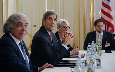 From left, US Secretary of Energy Ernest Moniz, US Secretary of State John Kerry and US Under Secretary for Political Affairs Wendy Sherman, sit during a meeting with Iranian Foreign Minister Mohammad Javad Zarif at a hotel in Vienna, Austria, Sunday, June 28, 2015. (Carlos Barria/Pool Photo via AP)